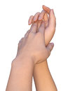 Gentle touch of female hands a closeup a that are touching each other palm to palm a woman touches a palm her hand with the Royalty Free Stock Photos