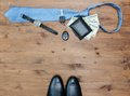 Gentleman concept tie dollars watches car key and shoes on wooden table Royalty Free Stock Images