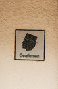 Gentleman sign for restroom mounted on a brick wall Stock Photography