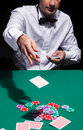 Gentleman in white shirt playing cards on black background Stock Photography