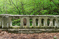 Geocache compartment a is cleverly built into an old ruined cement bridge rail Stock Photo