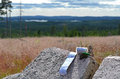 Geocache in wilderness a has been found the swedish geocaching is a global outdoor treasure hunt where participants try to locate Stock Photo