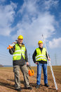 Geodesist two man equipment on construction site Stock Photos