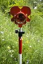 Geodetic reflect signal in a meadow Royalty Free Stock Images