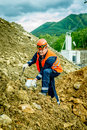 Geologist working with the ore Royalty Free Stock Photo