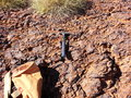Geology pick and bag with spinifex on ground iron ore Stock Photo