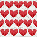 Geometric abstract polygonal red hearts seamless pattern background for use in design for valentines day or wedding Royalty Free Stock Photography