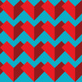 Geometric abstract seamless pattern with two  shades of red color heart elements on blue background  in mosaic tile Royalty Free Stock Photo