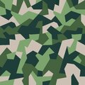 Fashionable geometric camouflage pattern. Seamless texture. Abstract green military or hunting camo background. Vector Royalty Free Stock Photo