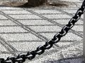 Pebble marble floor and large iron chain