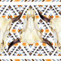 Geometrical ethnic seamless pattern with cow skull
