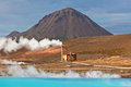 Geothermal power station and bright turquoise lake in iceland at summer sunny day Royalty Free Stock Photo