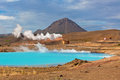 Geothermal power station and bright turquoise lake in iceland at summer sunny day Stock Photography