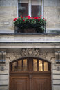 Geranium flowers above an old door in paris france Stock Photography