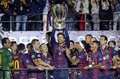 Gerard pique lifts the uefa champions league trophy barcelona players pictured during award ceremony held after final between Royalty Free Stock Image
