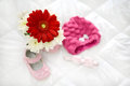 Gerbera pink and baby shoes headpiece in natural light Stock Images