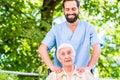 Geriatric nurse giving senior woman massage women Royalty Free Stock Images