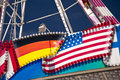 German an american flag on a giant wheel Stock Images