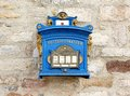 German blue mailbox on the brick wall Royalty Free Stock Photo