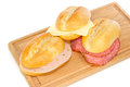 German bread rolls with mortadella, cheese and pepper cervelat Royalty Free Stock Photo