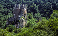 Majestic German castle surrounded by forest of trees Royalty Free Stock Photo