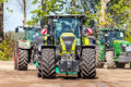 German claas axion tractor drives on track by a traktor pulling event
