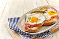 German Country breakfast of sliced ham and eggs