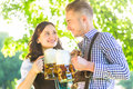 German couple in Tracht drinking beer Royalty Free Stock Photo