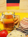 German cuisine style snack dish sausages sour cabbage potatoes and beer Royalty Free Stock Image