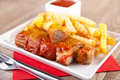 German curry sausage with french fries