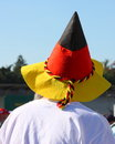 German fan with flag stock photo wearing national hat of germany colors Stock Photos