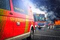 German firefighting trucks stands on a street near a fire