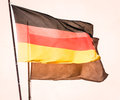 German flag in front of wall Stock Photography