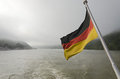 German flag on the stern of a ship sailing on the rhine river Royalty Free Stock Photography