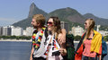 German friends traveling at Rio de Janeiro holding german flag. Stock Photo