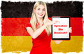 German language learning concept young woman holding tablet pc national flag of germany at the background collage clip art Royalty Free Stock Photography