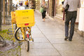 German mailman s bike mail with two deutsche post boxes on a street with people and lots of copy space Stock Photo