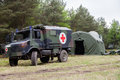 German military ambulance stands on rescue center system in a wood munster germany may may munster germany Royalty Free Stock Image