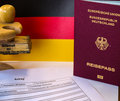German passport application form with passport backround flag and embassy stamp Stock Photos