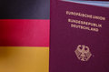 German passport on german flag backround close up of Royalty Free Stock Photo
