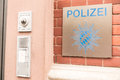 German police sign infront of a station with a bell next to it Stock Image