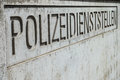 German police station tight crop on a nice carved in concrete sign infront of a Royalty Free Stock Images
