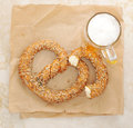 German pretzel sprinkled with seeds on the marble table. top vie