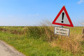 German road sign warning of road damage Royalty Free Stock Photo