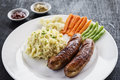 German sausage with mashed potato and vegetables meal Royalty Free Stock Photo