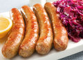 German Thuringer Bratwurst with Red Cabbage Royalty Free Stock Image