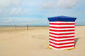 German wadden island borkum beach of with typical striped chair and volley ball net Stock Image