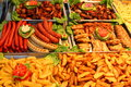 German wurst with french fries and and other steaks Royalty Free Stock Photos