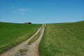 Germany countryside with dirt road loosing into the horizon green field under a blue sky Stock Photography