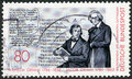 Germany shows portrait brothers wilhelm and jacob grimm deutches worterbuch circa a stamp printed in circa Royalty Free Stock Photography